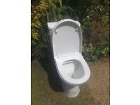 Modern design close coupled toilet in perfect condition
