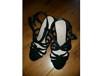 Brand new black heeled shoes size 4