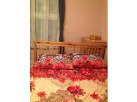One room with double bed,wardrobes and table