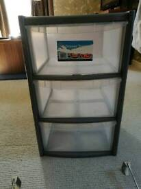 Three draws plastic storage unit