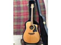 Garrison acoustic guitar including branded hard case