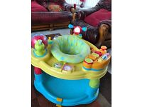 babys sit in play gym