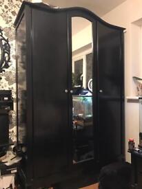 Black ornate triple wardrobe