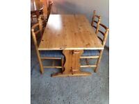 Solid pine kitchen table and four chairs + child booster base