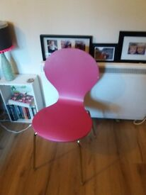 White table and four pink chairs.