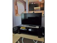 "Selling 42"" TV and TV stand"