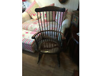 Lovely rocking chair with carved wooden design,in good condition, free local delivery..