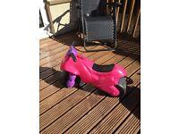Pink plastic balance motorbike