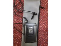 Set of 12 wireless radio receivers and belt pack transmitters with clip on mics