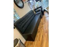 Long black leather sofa newly made