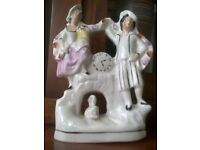 Antique Staffordshire Pottery Decorative figurine of a couple with a swan and a clock
