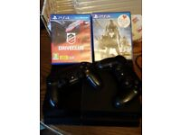 1TB Playstation 4 - 2 controllers - 2 games.