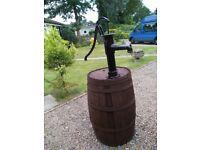 Fantastic medium sized oak barrel and cast iron vintage pump.