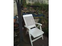 white garden chair very comfortable, reclines and has lock