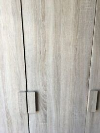 3 door wardrobe. excellent condition, light oak effect.