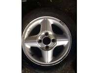 Single used FORD FIESTA 4 SPOKE 14 INCH ALLOY WHEEL with tyre slight curbing