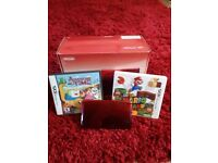 Nintendo 3ds (metallic red) with two games includes box
