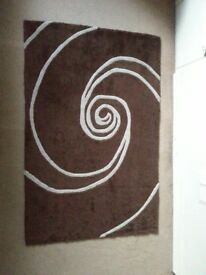 Brown rug with white swirl pattern