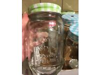Glass jars with lids and straws