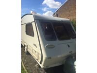 Lovely very clean non smoking 2 birth tourer with full awning, new carpet new wheels new curtains