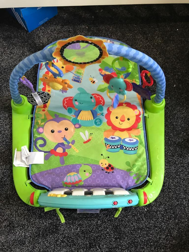 Fisher price play matin Liversedge, West YorkshireGumtree - Fisher price bright colourful play mat with jungle friends on it. Detachable toy bar and a piano at the feet for baby to kick. The piano is also detachable so as the child grows they can have a separate piano to play with. In a good condition