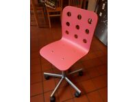 Pink office-style chair