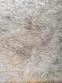 Grey fur rug 120cm by 70cm