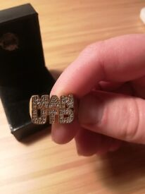 Man Utd 9 ct Gold plated ring with encrusted diamonds