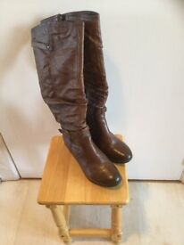 As new, ladies' knee-length brown boots.