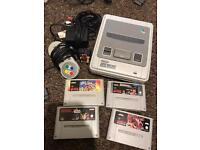 Really good condition snes with 4 games.