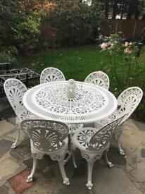 Cast aluminium Victorian table and 6 matching chairs