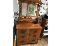 wooden chest of draws with mirror