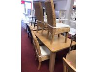 Extendable table and 6 Rattan effect chairs with cushions