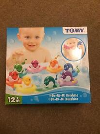 Do-re-mi dolphins kids bath toy