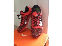 Nike Boys/girls running spikes for track or Xcountry size 5.5