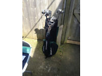 2 sets of golf clubs with brand new practice net, open to offers.