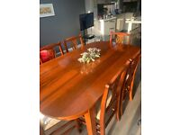 Solid oak folding table and 6 chairs good as new