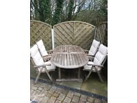 Teak 6 ft table and matching high back chairs, with cushions. Collection only