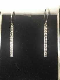 Sterling silver earrings with diamond design