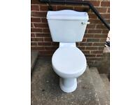 Traditional style close coupled toilet