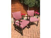 A pair of pink floral upholstered armchairs