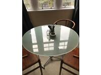 Glass dining table.