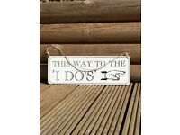 'This way to the I do's' wedding sign