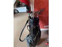 Wilson golf clubs and McGregor bag