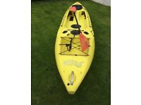 Kayak with paddle and seat