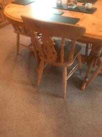 Solid pine extending dining table and four chairs.