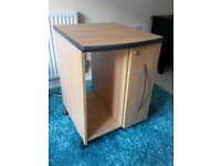Wood effect desk storage. Excellent condition. Stores cds. Easy to manover as on wheels.