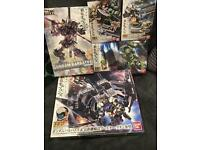 3X Gundam model kits + 2x mobile suit option sets