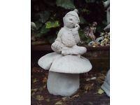 large pixie on a mushroom