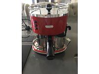 Red Delonghi coffee machine
